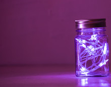 Lights Inside The Glass Jar Isolated, Colorful Light Glowing In The Dark Inside The Jar.