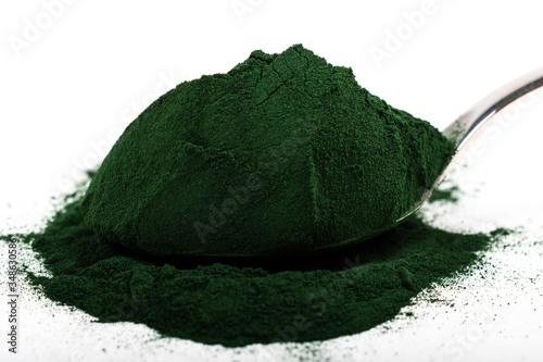 An isolated tablespoon of dried organic spirulina algae powder, on white or rustic background Tapéta, Fotótapéta