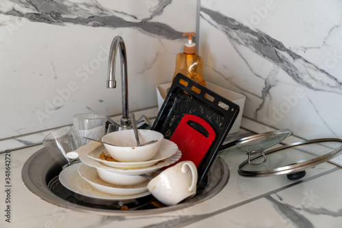 unwashed dishes left after the whole family ate Canvas Print