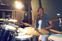 Male Musician Playing Drums In...