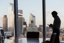Silhouette Businessman Using S...
