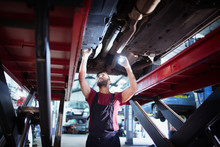 Male Mechanic With Flashlight ...
