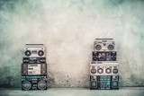Retro old design ghetto blaster boombox radio cassette tape recorders from 1980s front concrete street wall. Nostalgic Rap, Hip Hop, R&B music concept. Vintage style filtered photo