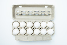 One Dozen White Eggs In A Carton Package, Top View Or Flat Lay