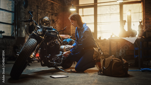 Fotografía Young Beautiful Female Mechanic is Working on a Custom Bobber Motorcycle