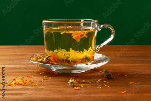 Photo Tea made of calendula is a therapeutic tea for various ailments