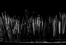 Close-up Of Incense Sticks Burning In Temple At Night