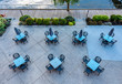 A birds eye view of empty tables outside a restaurant by the lake in Kelowna Canada