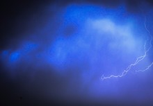 Low Angle View Of Lightning Strike And Sky