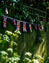 Union Jack Bunting On A Fence ...