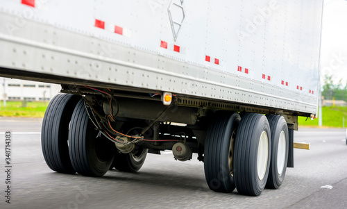 Dual wheels trailer axles on the running on the road dry van semi trailer with c Canvas Print