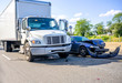 canvas print picture Road accident with damage to vehicles as a result of a collision between a semi truck with box trailer and a car