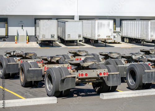 Row of trolleys with axles and fifth wheel tow hitch for semi trucks trains stan Canvas Print