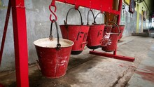 Row Of Red Fire Buckets Hanging