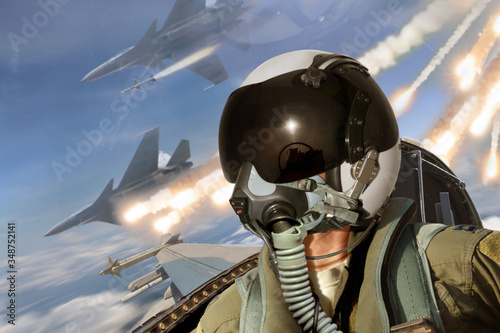 Fototapeta Pilot cockpit view during air to air combat with missiles flares chaff being dep
