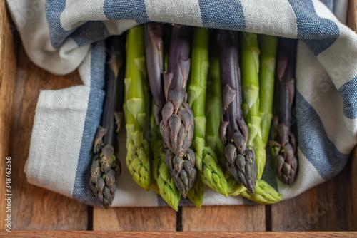 Fototapeta Asparagus. Fresh Asparagus. Green Asparagus. Bunches of green asparagus obraz