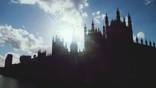 Silhouette Houses Of Parliament Against Cloudy Sky