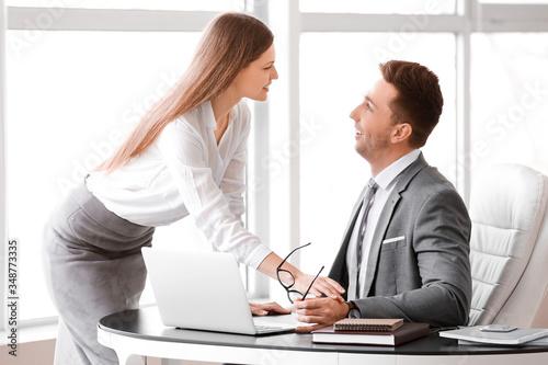 Fototapeta Sexy secretary seducing her boss in office