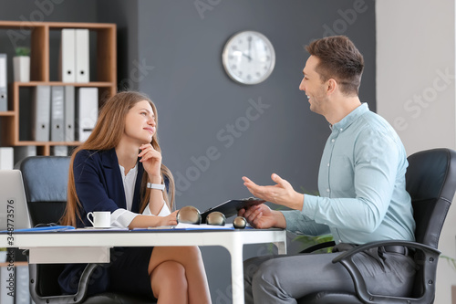 Fotografía Businesswoman and her male secretary working in office