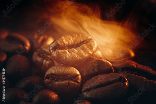 Fototapeta Coffee beans on the table fried with steam and hot close-up obraz