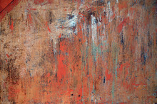 Rusty Metal Background With Old Peeled Paint On It.