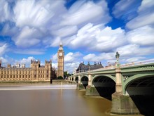 Houses Of Parliament And Big Ben By River Thames Against Cloudy Sky