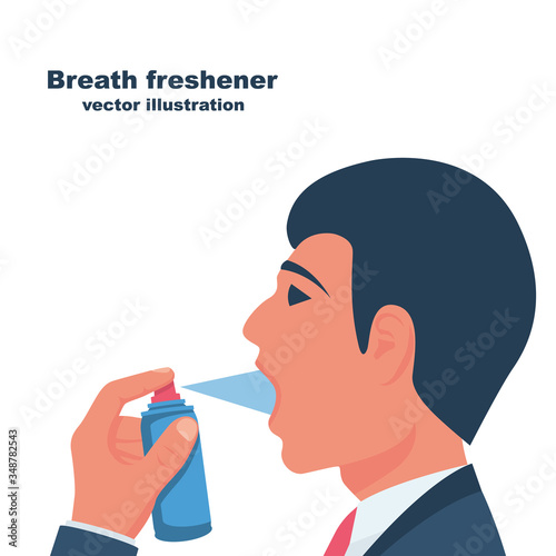 A young man uses breath freshener Canvas Print