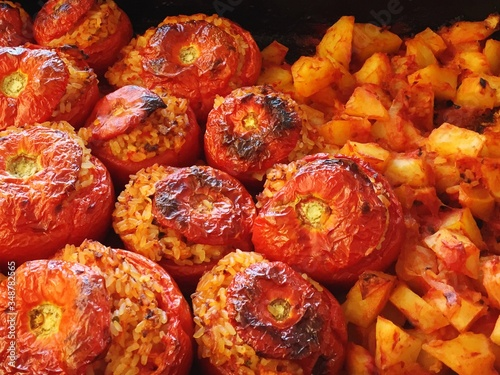 Close-up Of Stuffed Tomatoes With Rice And Potatoes
