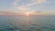 Static Shot of the Sunset in the Distance on the Beautiful Blue Ocean