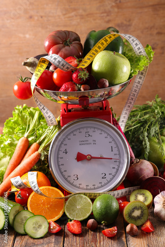Fototapeta assorted of fruit vegetable on balance scale concept obraz
