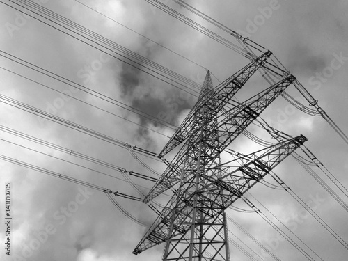 Fototapeta Low Angle View Of Electricity Pylon Against Cloudy Sky At Dusk
