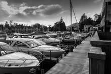 Boats Moored On Lake Windermere Against Sky