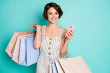 Portrait Of Her She Nice Attractive Lovely Pretty Cute Cheerful Cheery Girl Carrying Trendy Brandy Clothes Using Cell Ordering Drop Shipping Isolated Bright Vivid Shine Vibrant Blue Color Background