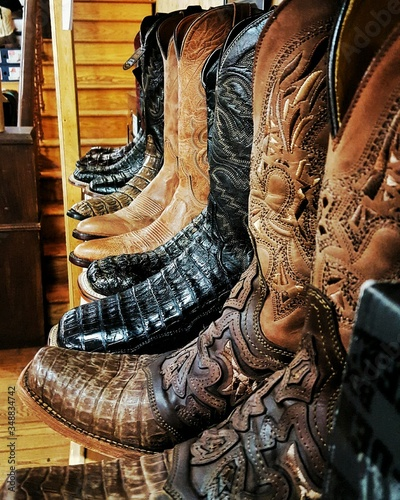 Various Cowboy Boots On Shelf For Sale At Store Canvas-taulu