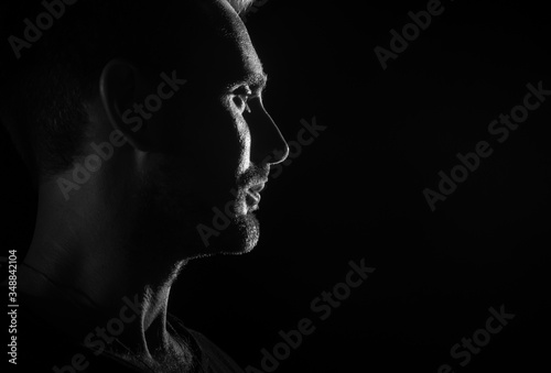 Fototapety, obrazy: Dramatic profile portrait of male person on dark background