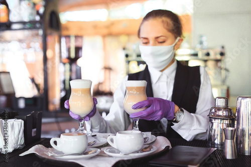 bartender in medical mask and gloves makes latte coffee. Canvas