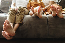 Barefoot Family Sitting On The...