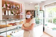 Female Bakery Owner Behind Cou...