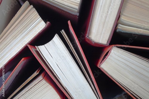 Old used hardback books, top view Slika na platnu