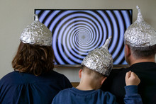 Family With Tin Foil Hat In Fr...