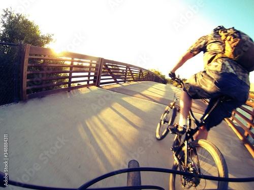 Photo Fish-eye View Of Man Cycling On Footbridge