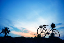 Silhouette Of Sunset And Cycli...