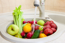 Washing Fruits And Vegetables In Sink After Shopping From Grocery Store During Coronavirus Covid-19 Quarantine Period. Concept Of Safety, Precautions, Reinsurance During Pandemic