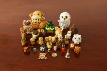 Toy Figurines Of Owls Of Different Shapes And Sizes On The Table