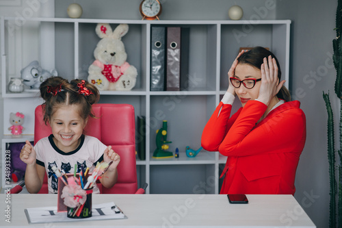 Small child practicing articulation with therapist at private lesson at home Canvas Print
