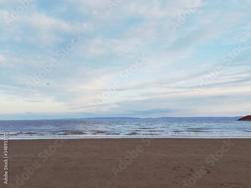 Fototapeta Scenic View Of Horizon Over Sea From Beach In Barry Island