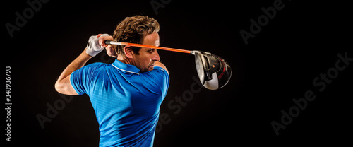 Fotografia Portrait of a golf player perfecting the swing isolated on dark background, bann
