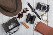 Travel concept - Airline tickets, passport, sunglasses and camera on wooden background