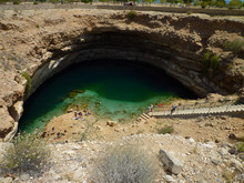 View Of Bimmah Sinkhole One Of The Most Beautiful Destinations In Oman. The Sink Hole Is Filled With Booth Salty And Fresh Water