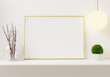Interior poster golden photo frame mockup on the shelf with small plant in pot and desk lamp on empty white wall background. . 3D rendering, illustration.